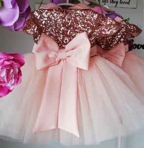Feestjurk Grote strik Luxe roosjes pink Handmade