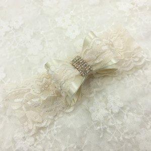 Luxe strik haarband met glitter steen Creme
